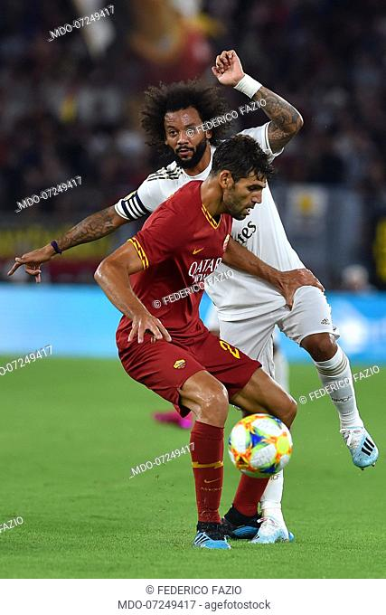 Roma football player Federico Fazio and Real Madrid football player Marcelo during the match Roma vs Real Madrid at the Olimpic Stadium