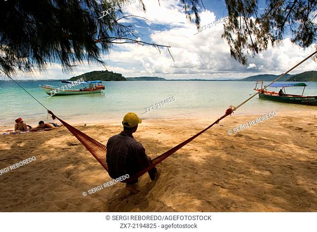 Lying in a hammock on the sea shore of the island of Koh Russei. Koh Russei (or Bamboo Island as it's commonly known) like most things in life