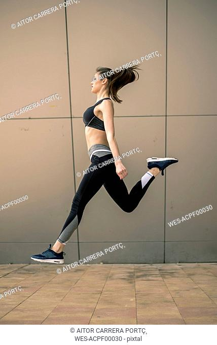 Sportive woman jumping