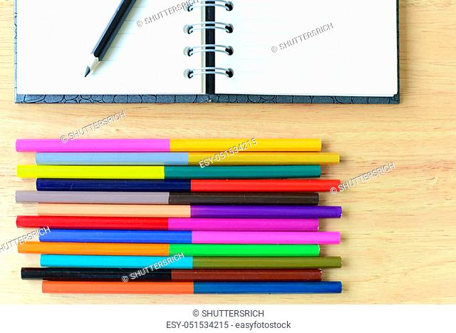 Back to school. Colorful Office and study art stationery objects on wood table with open notebook. Kid love to drowing