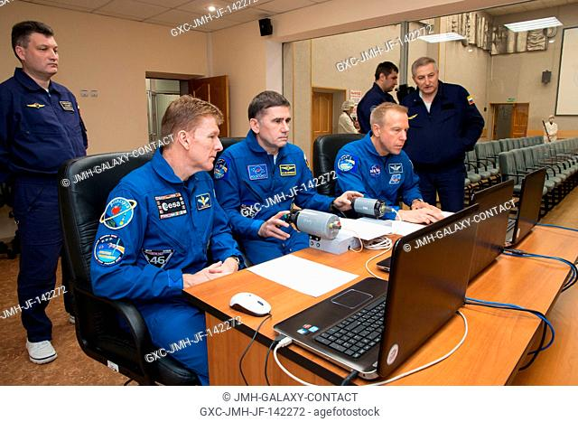 At their Cosmonaut Hotel crew quarters in Baikonur, Kazakhstan, Expedition 46-47 crew members Tim Peake of the European Space Agency (left)