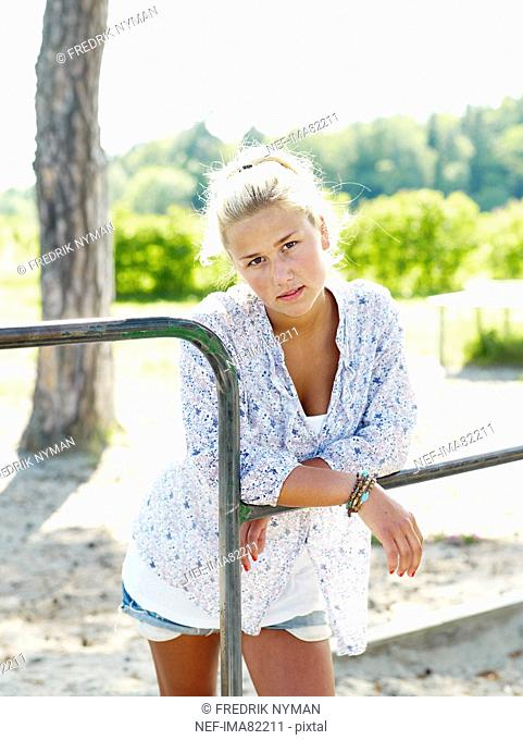 Young woman leaning on railings