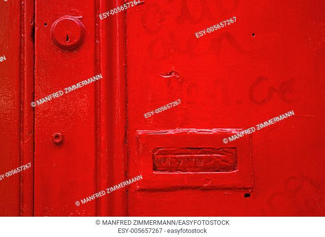 Cutting of old, bright red door in Dublin. Ireland series in detail