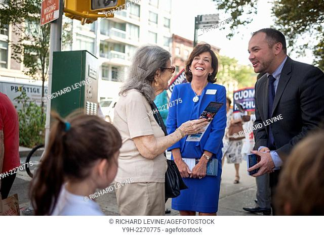 Gov. Andrew Cuomo's running mate, Kathy Hochul, center, campaigns with NYC Councilmember Corey Johnson in the Penn South housing complex in Chelsea in New York