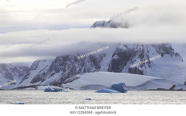 Mountains and glacier near Lemaire Channel, Antarctic Peninsula; Antarctica