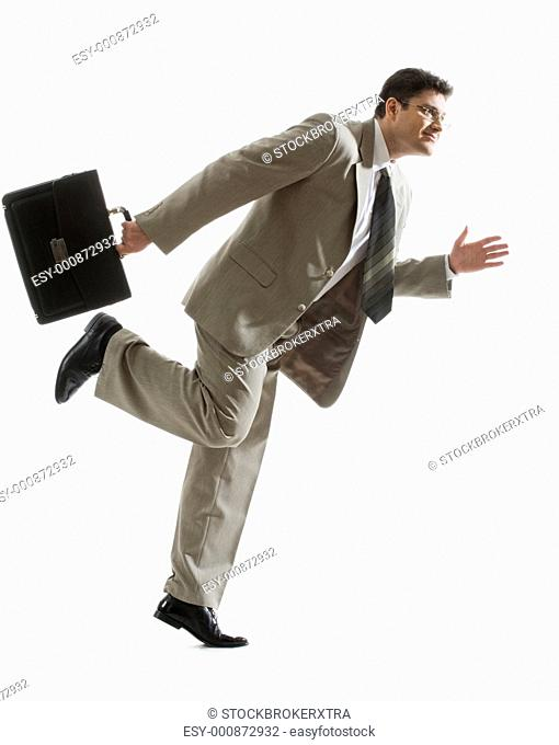 Portrait of fashionable partner with briefcase ready to run