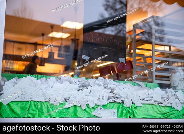 23 January 2020, Bavaria, Ansbach: Receipts of sold bakery products are lying in a shop window in a bakery in protest against the current receipt obligation