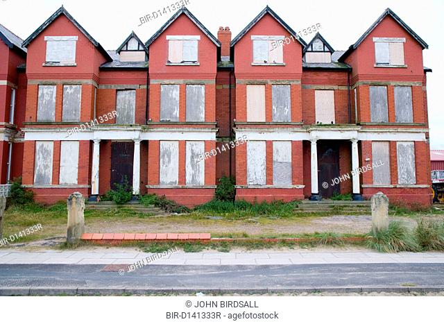 A row of houses boarded up waiting to be demolished for the housing market renewal initiative programme in the Bootle area, Liverpool, England