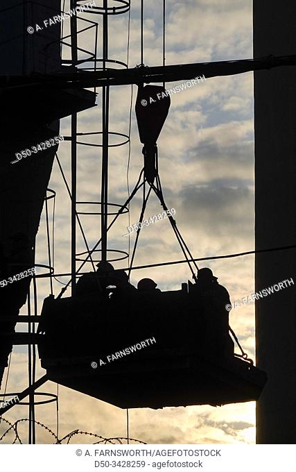 Kiev, Ukraine A crane lifts workmen in Podil, a hip and working class section of town