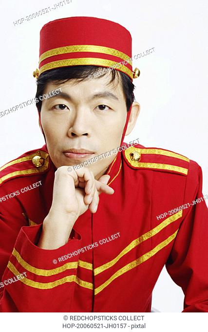 Portrait of a bellhop with his hand on his chin