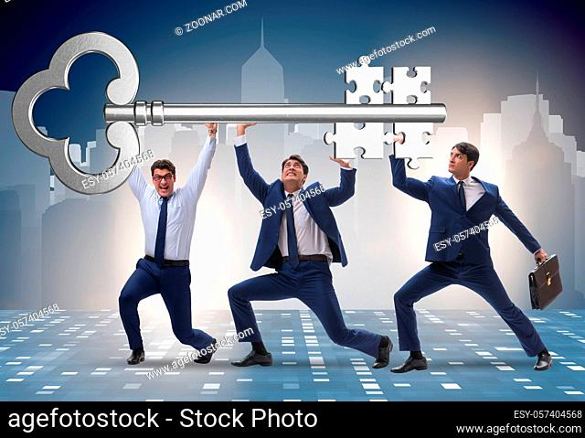 The businessmen holding giant key in business concept