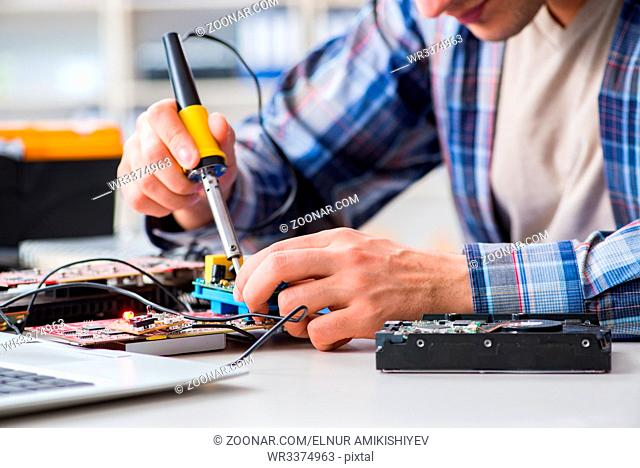 Computer hardware repair and fixing concept by experienced technician