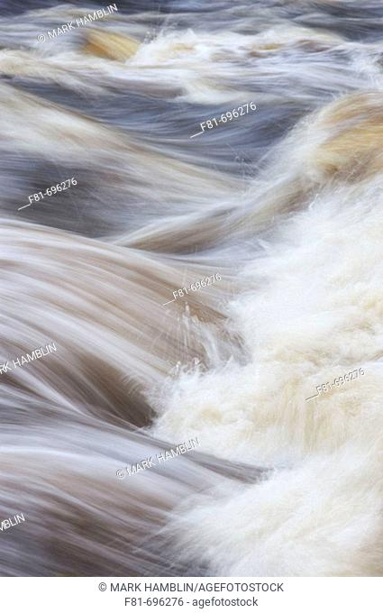 Close-up section of fast flowing river  Scotland  October