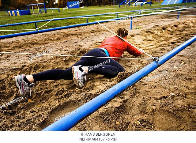 Woman crawling on ground