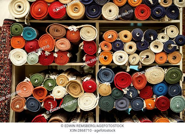 Jaipur, India - Rolled up traditional oriental rugs