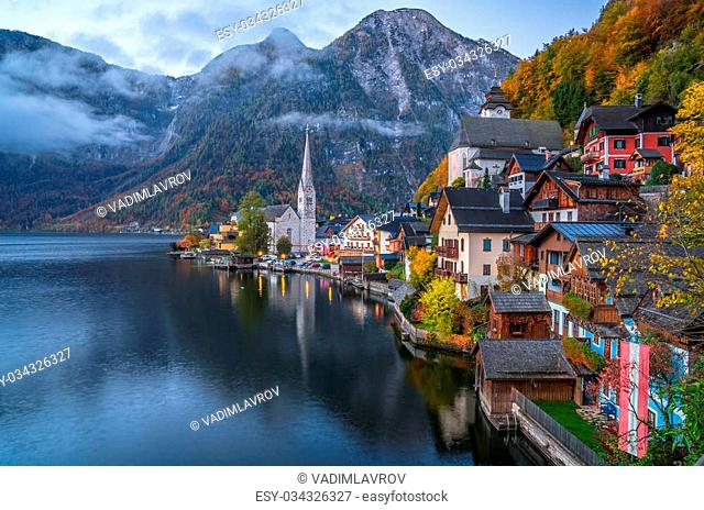 Scenic picture-postcard view of famous historic Hallstatt mountain village with Hallstatter See in the Austrian Alps in twilight during blue hour at dawn in...