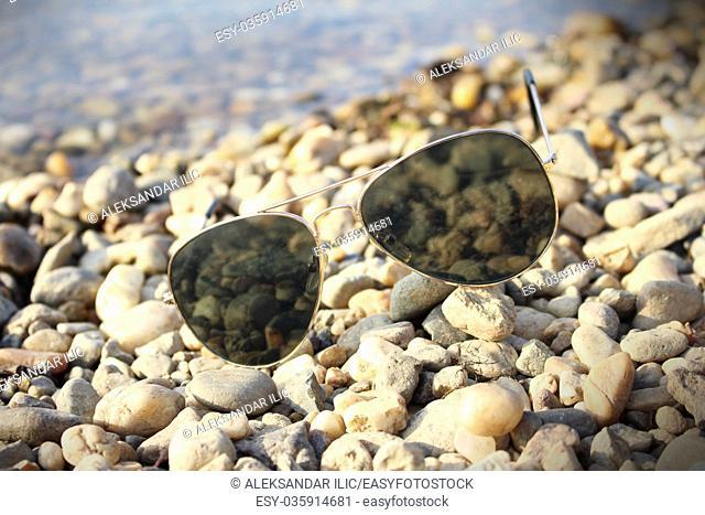 Sunglasses resting on the beach