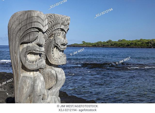 Honaunau, Hawaii - Two ki'i (wood carvings of Hawaiian gods) at Pu'uhonua o Honaunau National Historical Park. In ancient Hawaii, this was the place of refuge