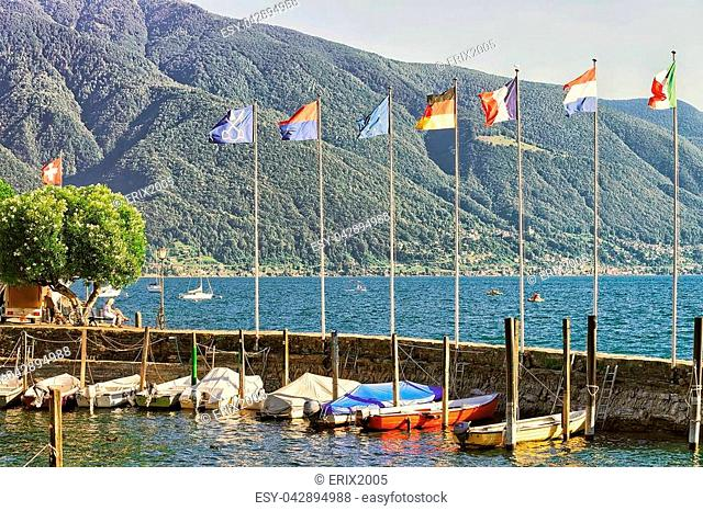 Ascona, Switzerland - August 23, 2016: Boats at the embankment of the luxurious resort in Ascona on Lake Maggiore in Ticino canton in Switzerland