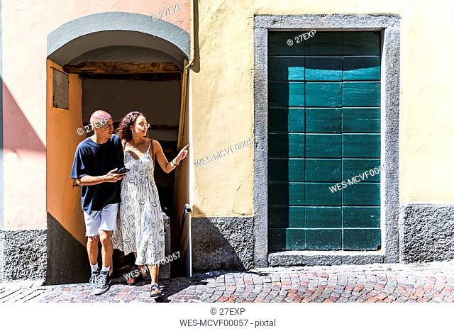 Young couple exploring the city, Lecco, Italy