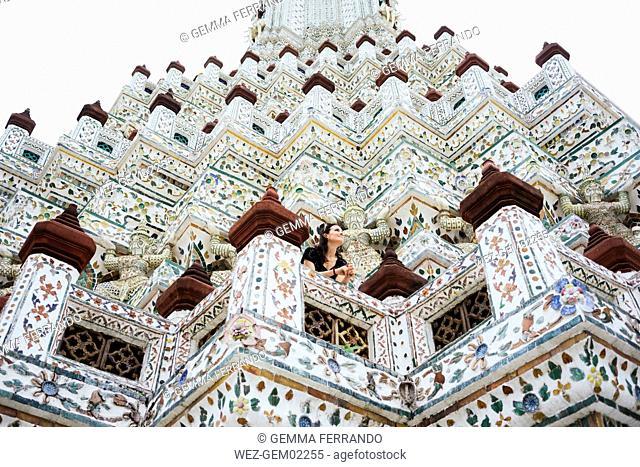 Thailand, Bangkok, Wat Arun, Portrait of smiling woman visiting the Buddhist temple