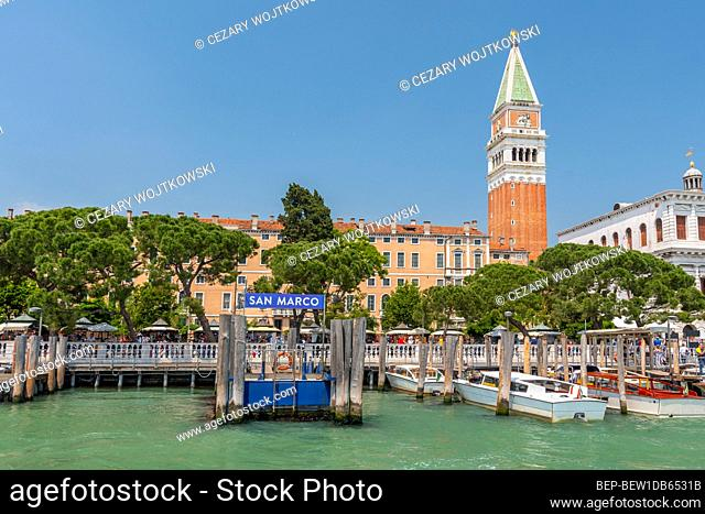 View of the lagoon with Campanile on Piazza di San Marco and water bus ( vaporetto ) stop, Venice, Italy