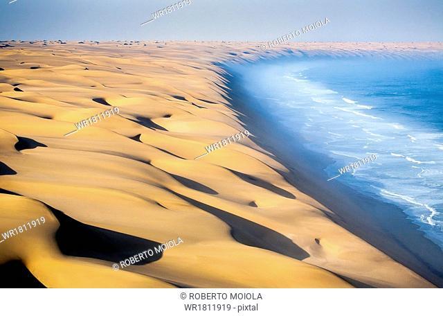 Where the dunes of the Namib Desert meet the Atlantic Ocean, Namibia, Africa