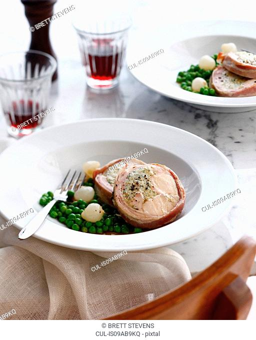 Bowl with ballotine rabbit with peas and shallots