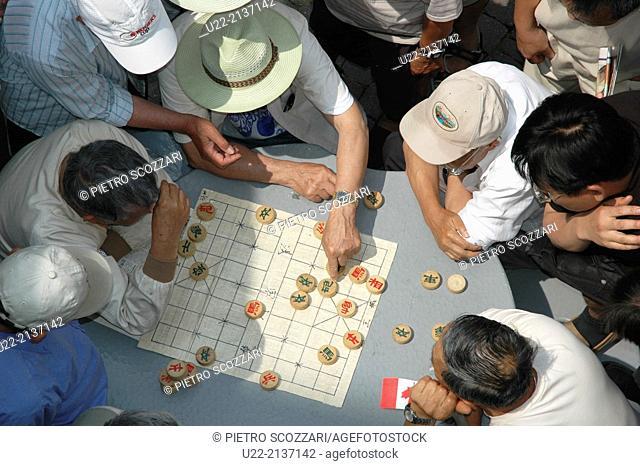 Toronto Canada: Chinese immigrants playing Xiangqi Chinese chess in Chinatown