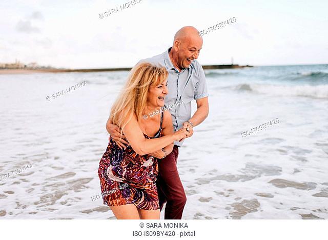 Couple having fun on beach, Estoril, Lisboa, Portugal