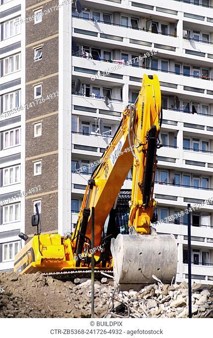 Demolition site near 1960s residential blocks, West London, UK