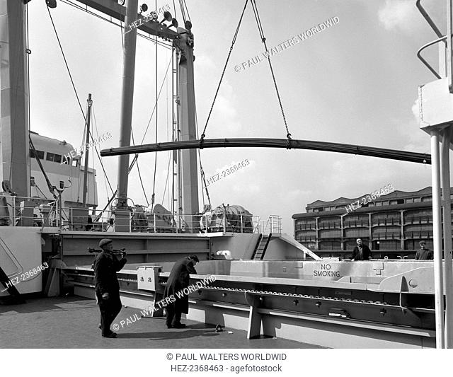Steel bars being loaded onto the 'Manchester Renown', Manchester, 1964. British steel products were in demand worldwide during the 1960s due to their high...