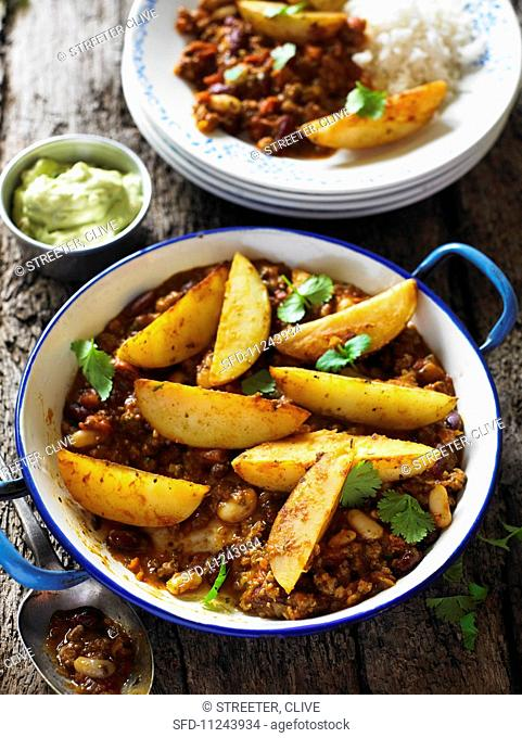 Chilli con carne with potato wedges