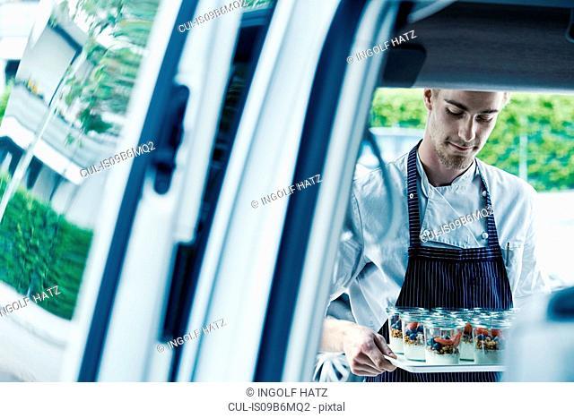 Chef loading food in van