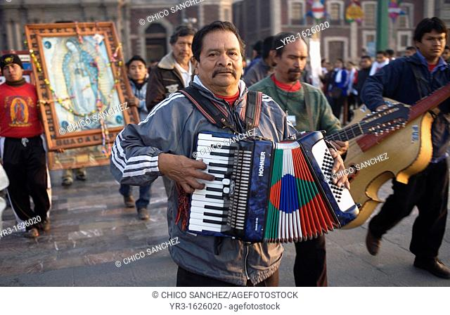 Musicians play Mexican northern style music outside the Our Lady of Guadalupe Basilica in Mexico City, December 9, 2011  Hundreds of thousands of Mexican...