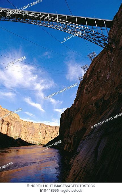 Glen Canyon Bridge over Colorado River viewed from the Glen Canyon dam powerhouse.  Near Page, Arizona, USA