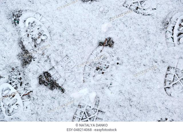 traces of shoes on white snow, top view, full frame