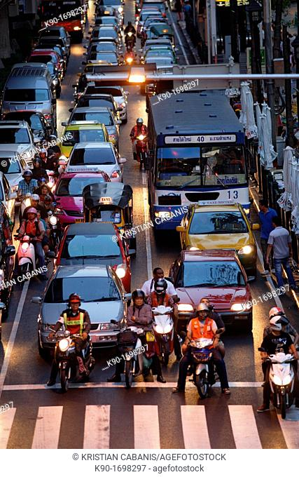 Heavy traffic seen from backside and from above on Ploenchit Road, Central Business District of Bangkok, Thailand, Southeast Asia