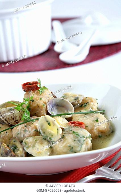 Monkfish fishballs with clams in green sauce