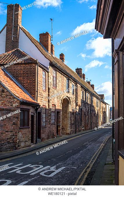 The buildings on the left (north) side of Priory Lane were originally part of the Benedictine priory; dating from 15th century. Kings Lynn, Norfolk UK