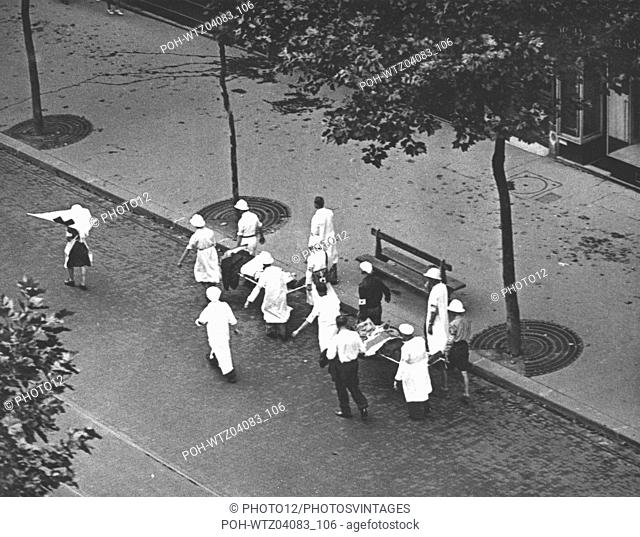 Strecher-bearers from the Red Cross transporting two injured persons on the Boulevard Saint Michel during the Paris uprising  World War II Liberation of Paris