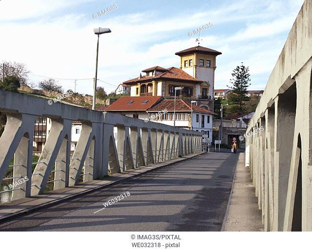 Manor house and bridge over Deba river, Asturias/Cantabria border. Bustio, Asturias, Spain