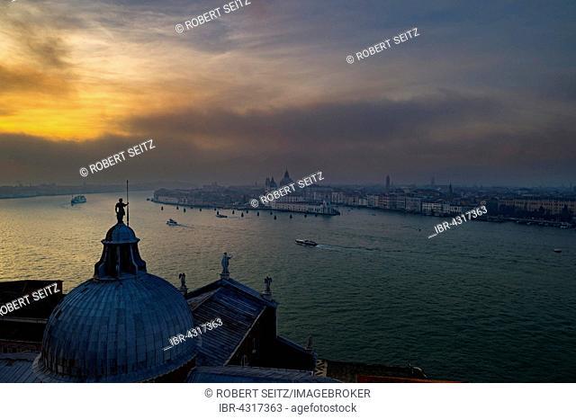 View of Church of San Giorgio Maggiore to Basilica di Santa Maria della Salute at sunset, Venice, Veneto, Italy