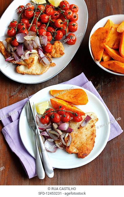 Turkey schnitzel, sweet potatoes and baked tomatoes