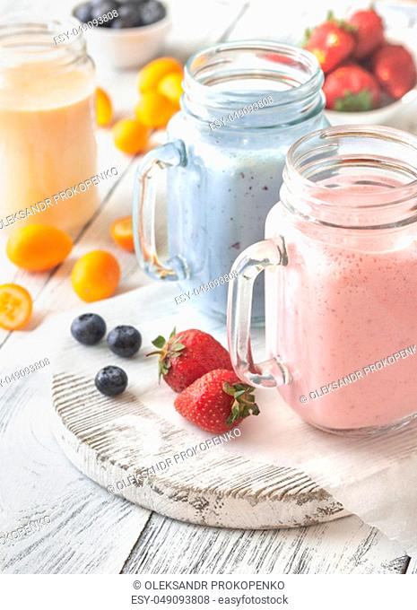 Berry smoothies on the wooden board