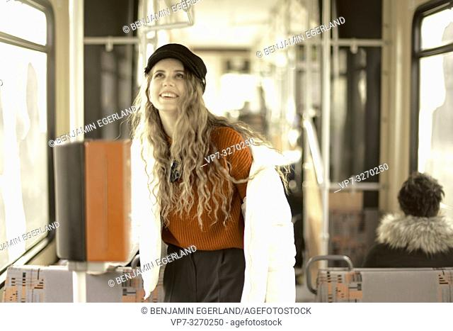 young woman in public transport, in city Cottbus, Brandenburg, Germany