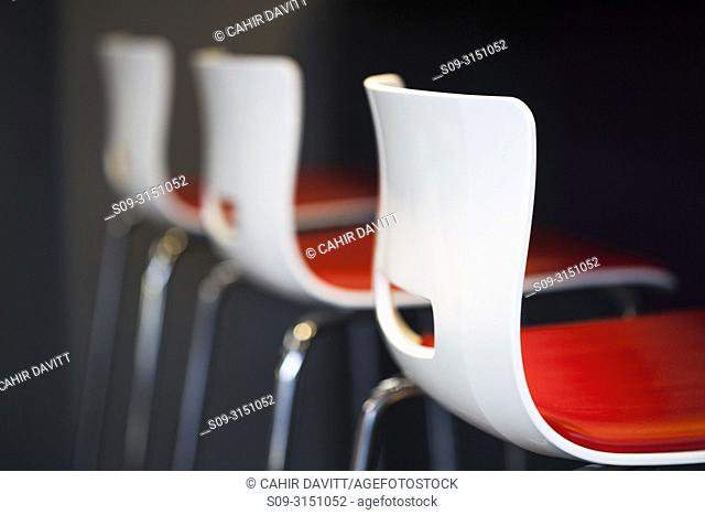 Contemporary styled modern chairs arranged in a row