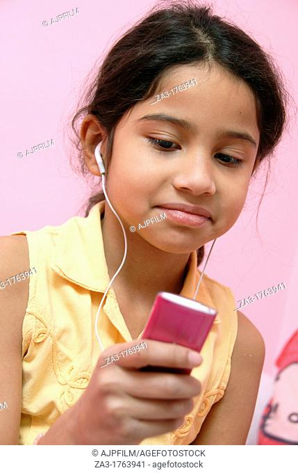 12 years old girl listening to music