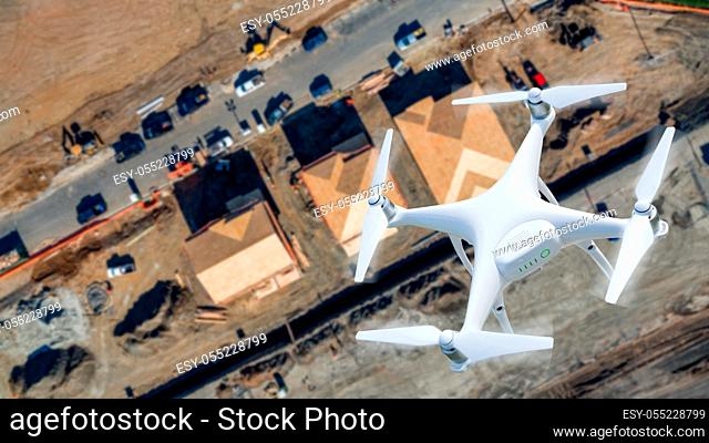 Unmanned Aircraft System (UAV) Quadcopter Drone In The Air Over Construction Site