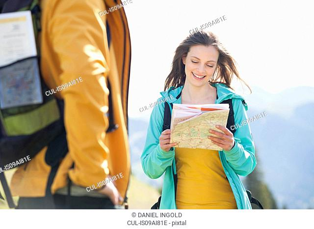 Mid adult woman looking at map